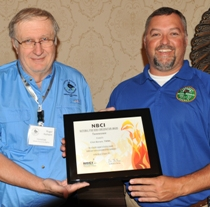Tennessee quail coordinator Roger Applegate, left, presents the NBCI National Fire Bird Conservation Award to Clint Borum.