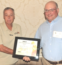 Bob Glennon, left, accepts NBCI National Fire Bird Conservation Award from Virginia quail coordinator Marc Puckett
